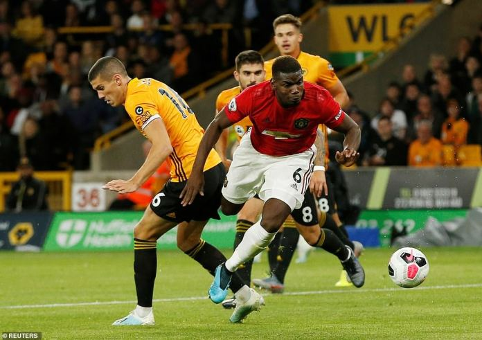 Pogba won the penalty for United after being pegged back as Conor Coady tips him up in the Wolves penalty area