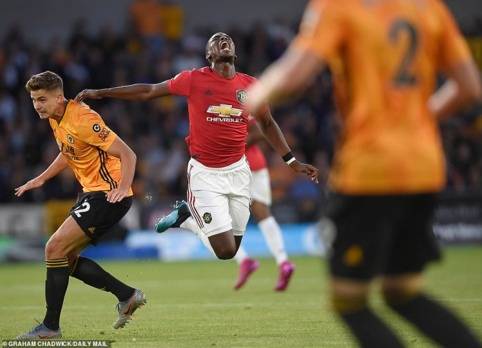 United midfielder Pogba falls theatrically to the floor following pressure from Leander Dendoncker in the first half