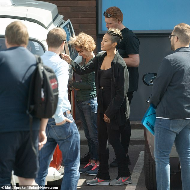 Catchign up: The Strictly crew caught up outside the location in west London