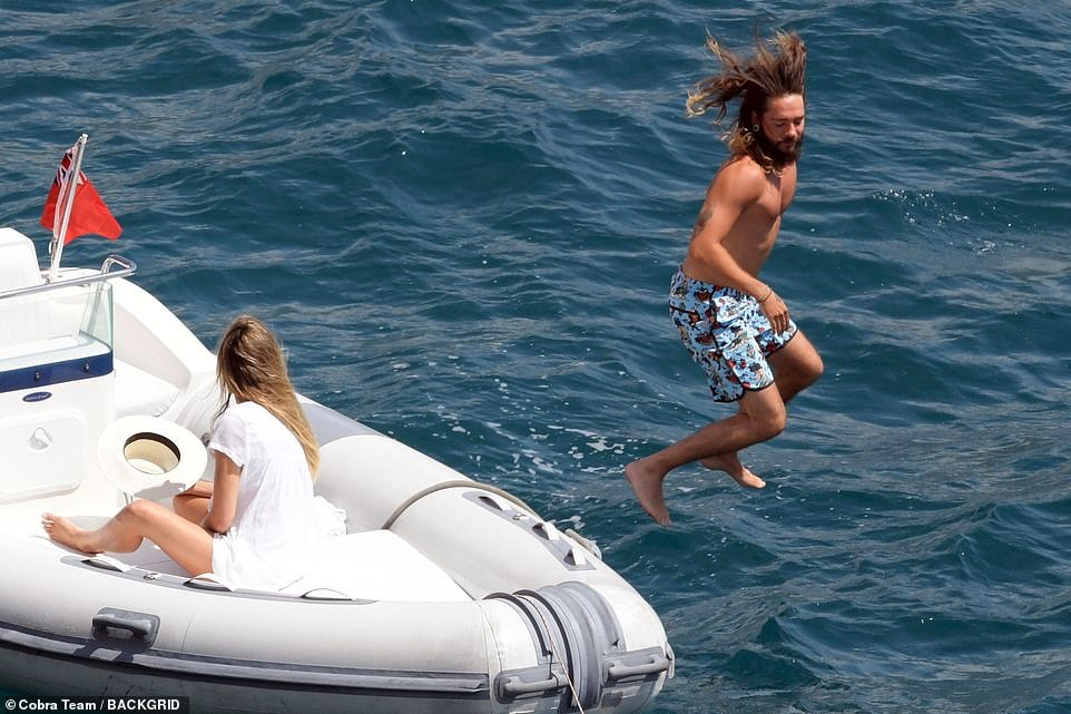 Woah! Tanned Tom was pictured showing off his toned physique as he jumped into the water alongside his adoring new bride