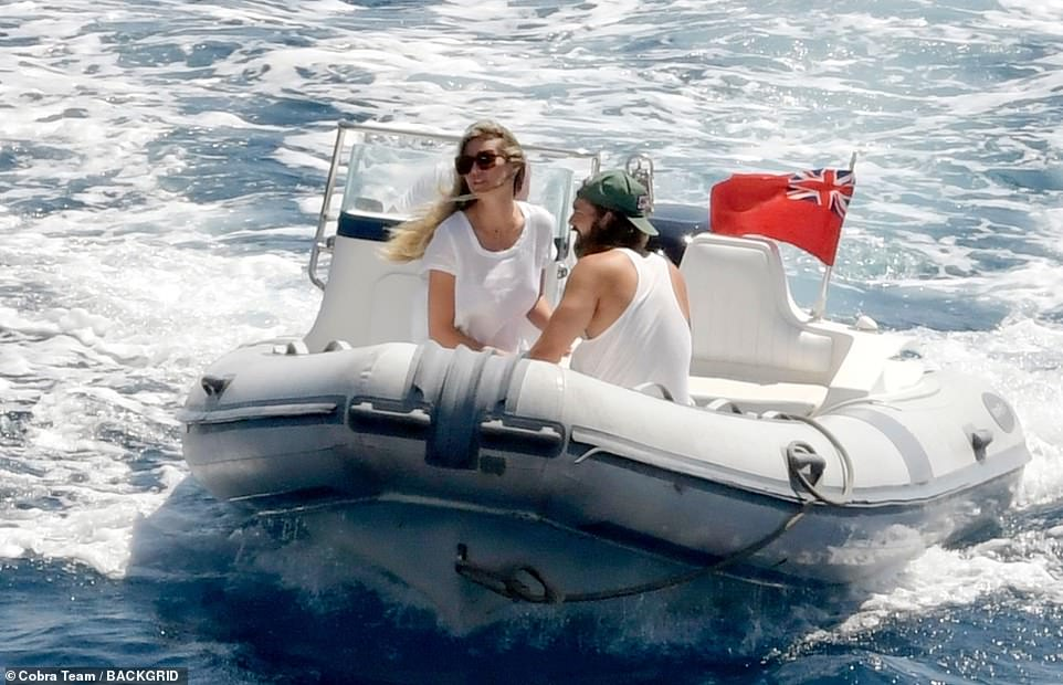Giving Bond a run for his money: The couple looked picture perfect as they headed back to their yacht