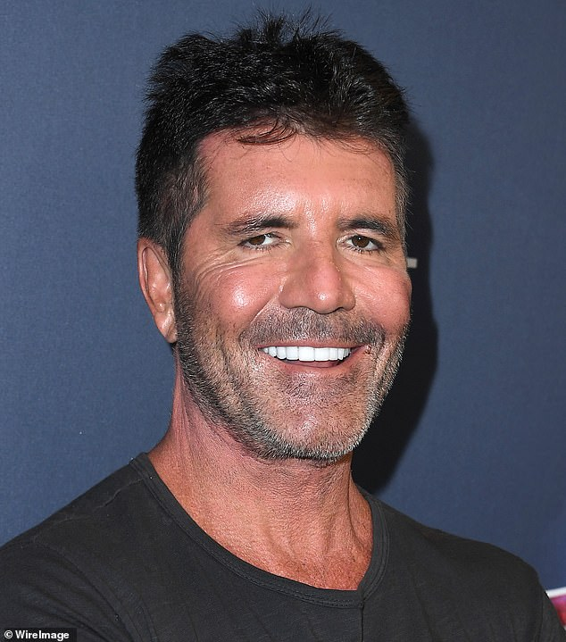 Handsome: Simon showed his sleek looks and beaming smile on the America's Got Talent live shows
