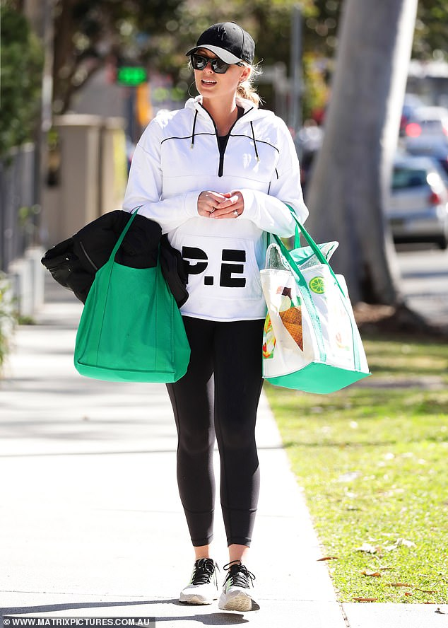 Glowing: Elsewhere, Sylvia (pictured) was seen lapping-up the winter sun while walking back from her local Woolworths in Double Bay