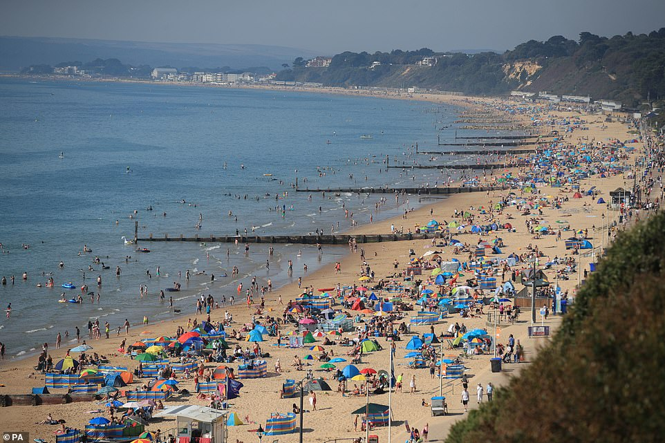 Bournemouth beach was pickled with people who brought large umbrellas and tents with them to offer some shade