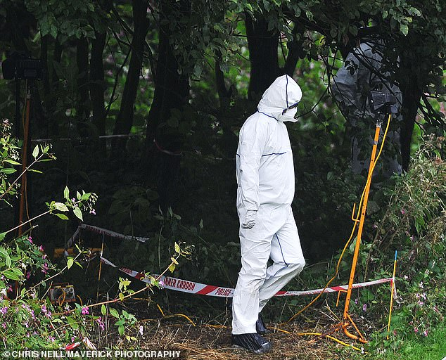 Police, pictured at the scene today, said her disappearance was 'completely out of character'