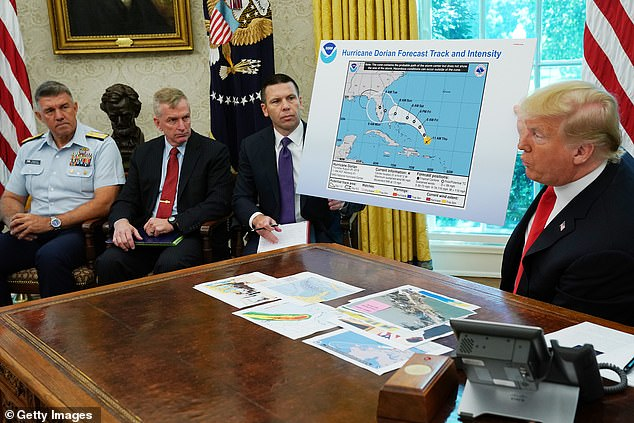 A map the president held up earlier in the day at a hurricane briefing had been altered to include Alabama. It's included in an area in the upper left of the storm's actual pathway