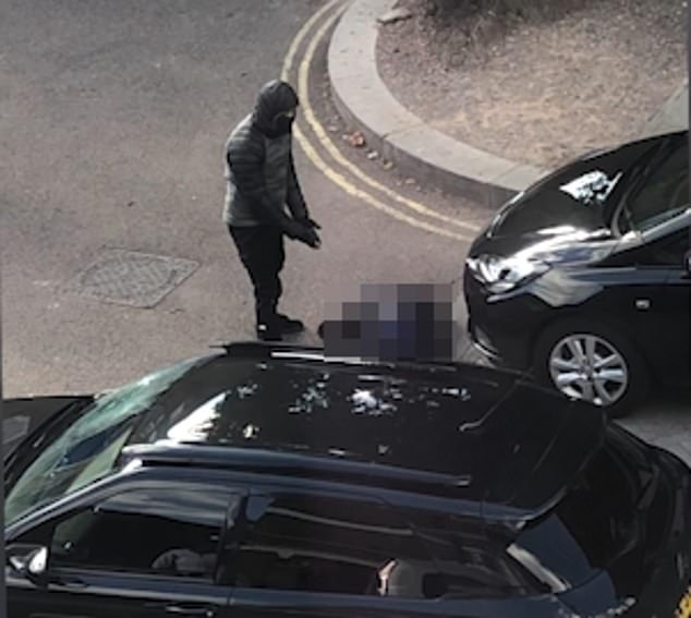 Stills from the video show a man standing over Mr Ramsey Johnson after he shot himself