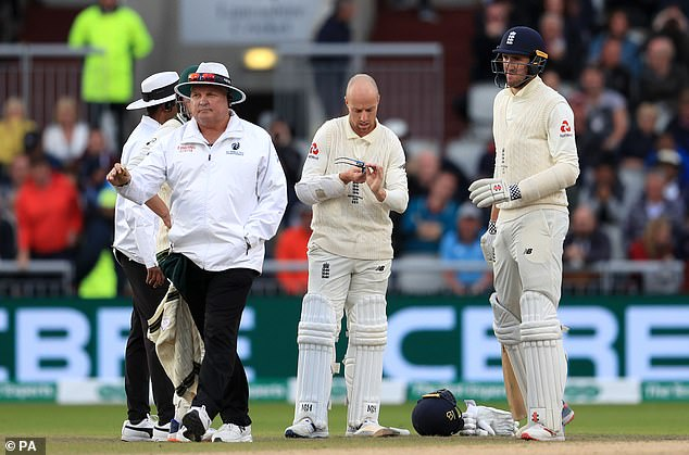 Leach cleans his glasses while batting with Craig Overton during England's second innings