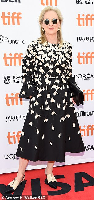 Streep's frock had a round neckline and long sleeves with bell cuffs and she carried a designer black purse