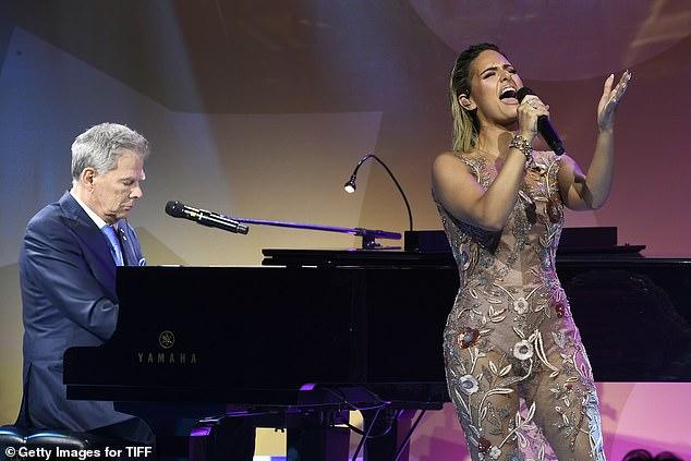 David and Pia: David Foster accompanies singer Pia Toscano on piano