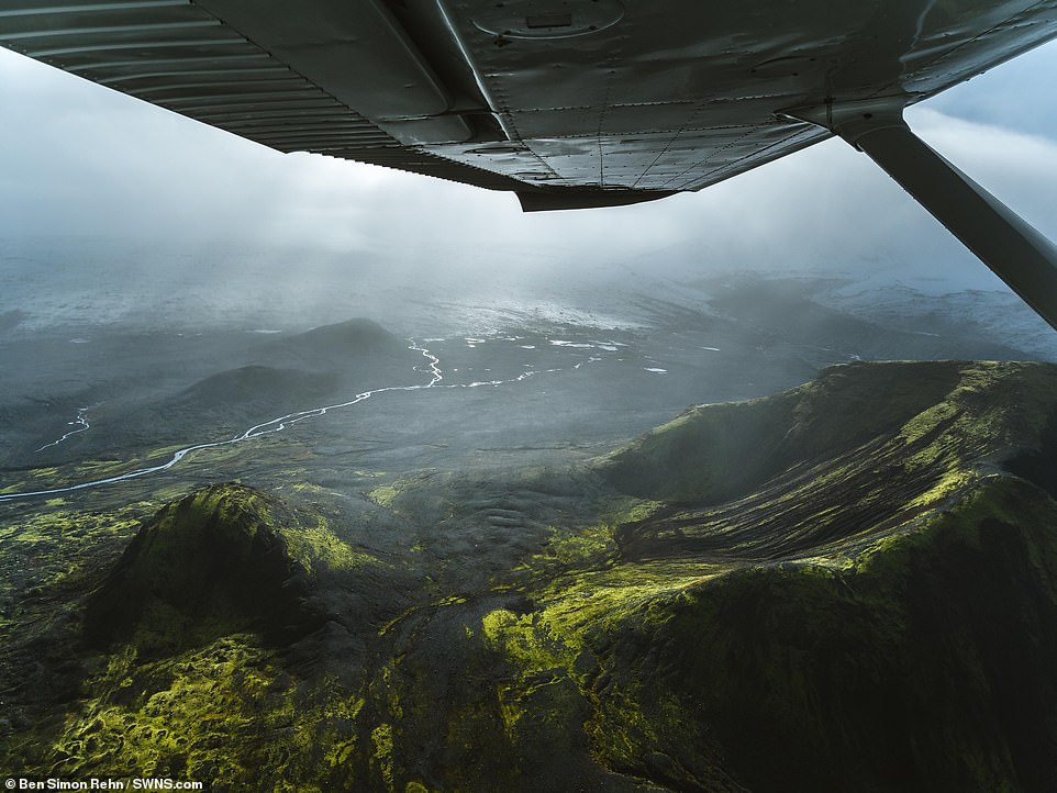 As well as snowy scenes, Ben also captured images showing lush green hills in Iceland, pictured