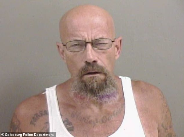 Seeing double! Illinois police are hunting for Todd W. Barrick Jr, 50, (above) who is wanted for a parole violation related to meth possession and coincidentally looks uncannily like Walter White of Breaking Bad