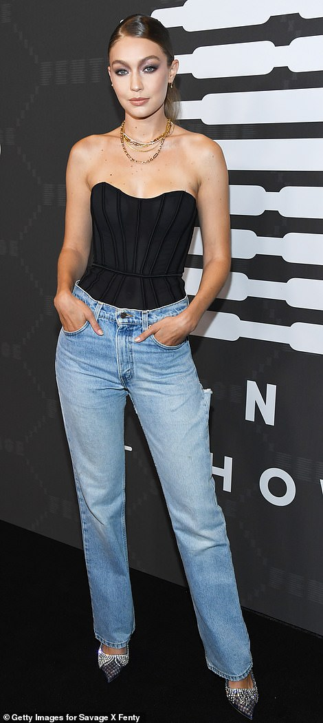Jean-ius: Gigi worked a black tube top and relaxed blue jeans for the high-end event