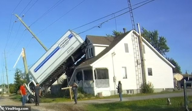 The clip, taken by Denis Lefebvre's dashcam, shows the unbelievable crash in Alban, Canada, which left the truck stuck in the roof of a house