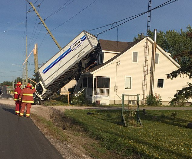 The truck's passenger Dylan Cox told CTV News: 'I had no idea what was going on at first. 'I had to gather my senses, gather my stuff, and then leave the truck. And that's when I noticed we're on a house'