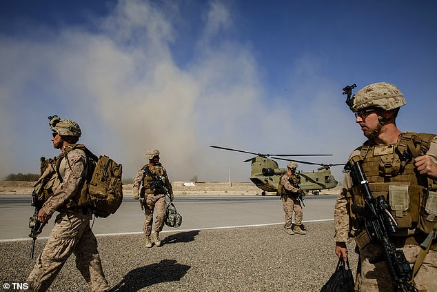 U.S. Marines disembark from a U.S. Army helicopter at Camp Bost, Helmand Province, on Oct. 29, 2017. Trump said coalition forces were hitting enemies like never before