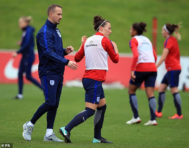 Sampson (left) pictured alongside right-back Lucy Bronze during a training session in 2017