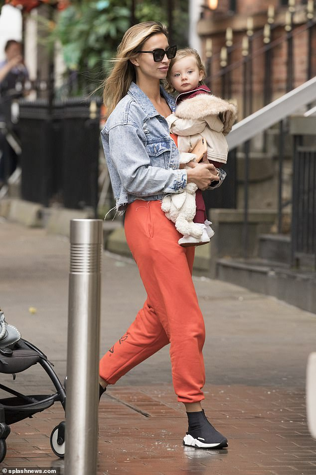 The former TOWIE star, 29, looked effortlessly cool for her mother-daughter outing, keeping comfortable in a bright orange jumpsuit and Balenciaga trainers