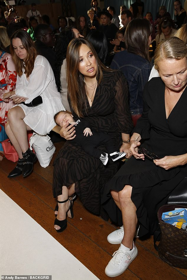 Adorable:Her little one was also dressed up for the event, as he wore a black onesie and monochrome chequered slip-on Vans