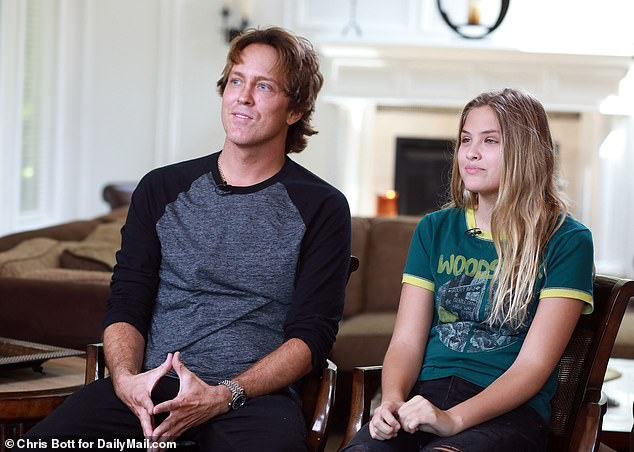 Dannielynn, daughter of Anna Nicole Smith, is on the right and is interviewed by her father Larry Birkhead (left)