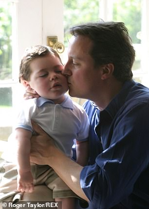 David Cameron and his son Ivan in 2004