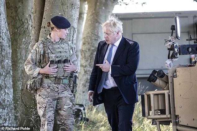 Prime Minister Boris Johnson talks with Lt Alice Strawbridge of the Light Dragoons during his visit on Thursday