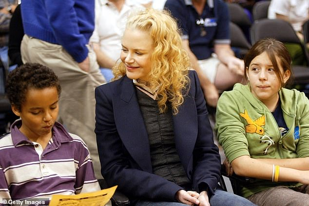 Rift: Like their father, Bella and Connor are practising Scientologists.The fact that Nicole isn't a member of the religion likely makes her a 'suppressive person'. Scientologists are encouraged to 'disconnect' from so-called SPs because they are considered a barrier to spiritual growth. Pictured: Nicole with her adopted children at an NBA game in Los Angeles in December 2004