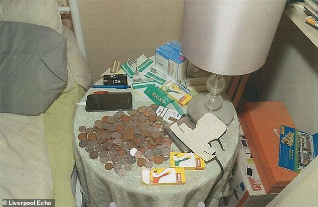 Coins, cigarette rolling papers and a filters were found on a bedside table among rubbish