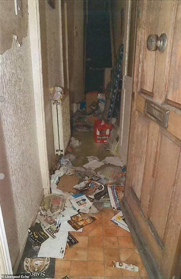 This disgusting hallway of the Toxteth, Liverpool home which the pair had lived in since 2003
