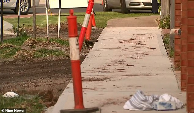 A trail of blood stretching almost 20 metres could be seen staining the footpath on Saturday