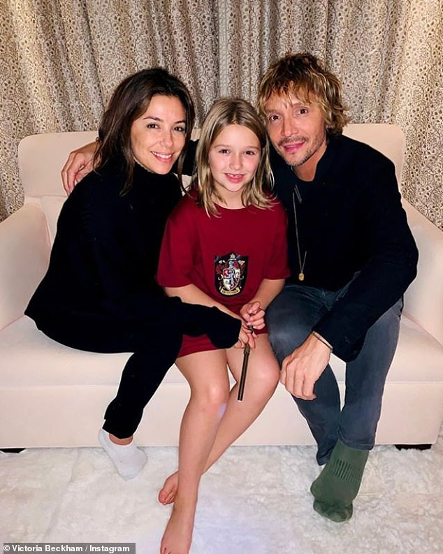 Sweet:Victoria Beckham has shared an adorable photo of her daughter Harper posing alongside her godparents, actress Eva Longoria and hairstylist Ken Paves
