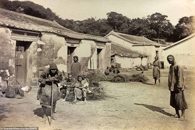 Locals sit outside a hut in a Chinese village. Only a few thousand people lived in Hong Kong when it came under British control in 1842, but that had risen to nearly 400,000 by the start of the 20th century and seven million by the 21st