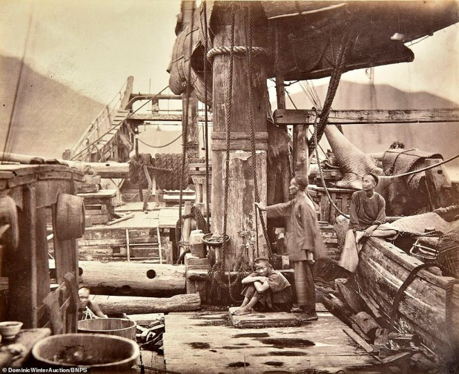 Locals aboard a junk, a type of Chinese sailing ship which has been used for hundreds of years. They were deployed against the British during the First Opium War that led to Britain taking control of Hong Kong