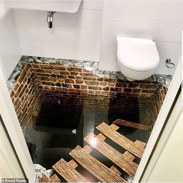 'Imagine going here after a drink!' This ominous looking loo, pictured in an unknown location, features a glass floor and a pit