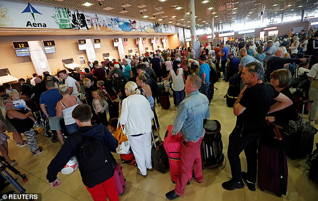 Thomas Cook passengers queue in front of check-in desks on the second day of repatriations at Reus airport last week