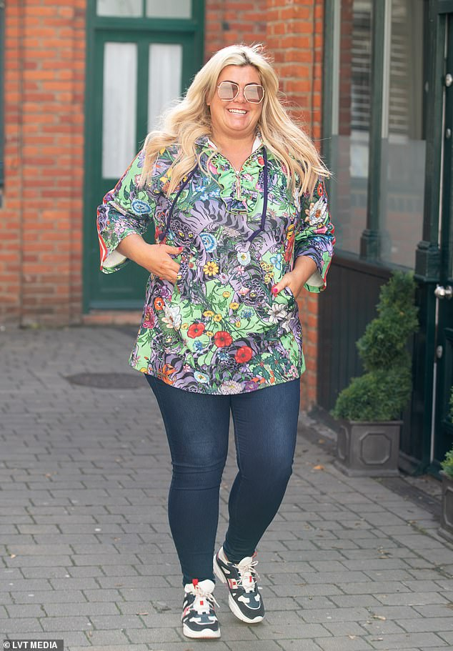 Fashion: The TOWIE star looked stylish in a colourful hooded top as she sauntered along to her eponymous boutique