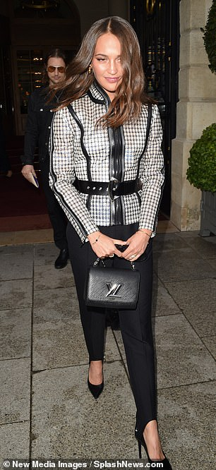 Style: The Danish Girl star paired this with black cigarette trousers and vertiginous heels, as she toted a handbag by the luxury fashion brand