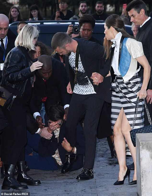 Oh no: The man was yanked free from Justin's leg by security as a shocked Jessica looked on