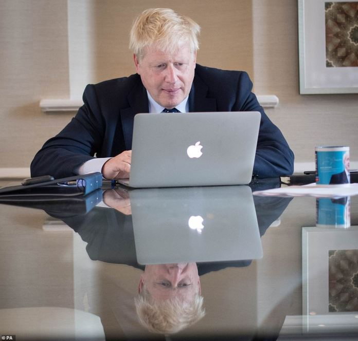 If the EU refuses to negotiate, Britain will leave without agreement, according to a senior government source. Pictured: Mr Johnson on Tuesday
