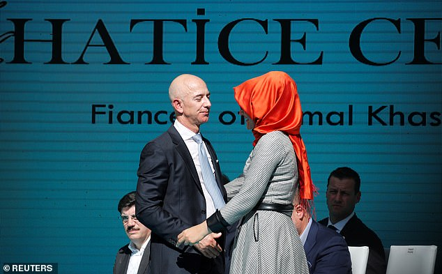 Jeff Bezos, pictured left with Cengiz today, is the owner of the Washington Post where Khashoggi was a columnist