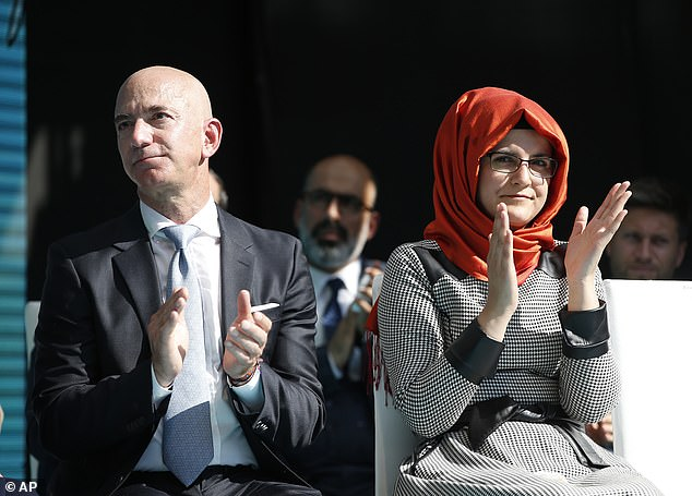 Washington Post owner Jeff Bezos, left, and Hatice Cengiz, right, applaud a speaker during today's memorial ceremony in Istanbul where Khashoggi died