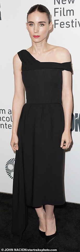 Stylish: Rooneycompleted the look with pointy black pumps, and parted her sleek hair down the middle