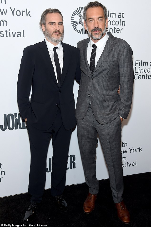 Gentlemen jokers:Joining Joaquin at the photo call as well was Joker's director Todd Phillips, in a grey patterned suit