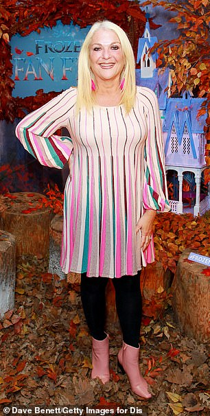 Glam: The presenter, 57, looked glamorous in pale pink mini shift dress with bell sleeves and vibrant segments of green, black and pink as she showcased her killer frame (pictured right in 2006)