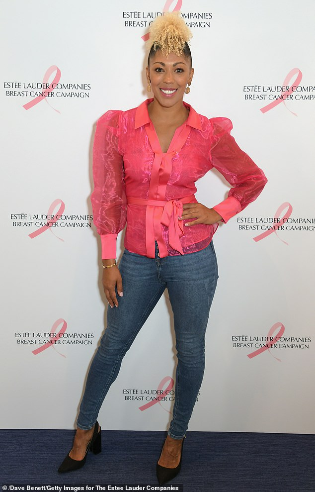 Fun:This Morning regular Dr Zoe Williams also supported the cause with a fuchsia pink blouse with a peplum body, blue jeans and black heels