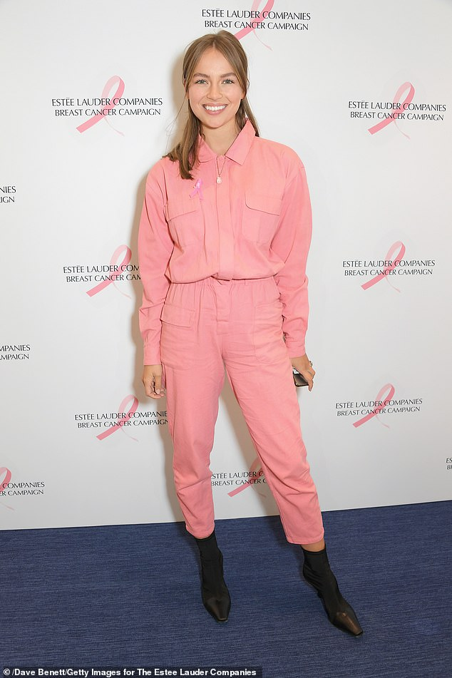Colourful:Emma Louise Connolly - who is engaged to Made In Chelsea star Oliver Proudlock - confidently supported the charitable cause in a pink boiler suit