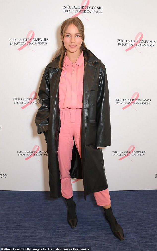 Fun: The model, 28, teamed her all-pink look with a matching leather overcoat as she arrived for the event