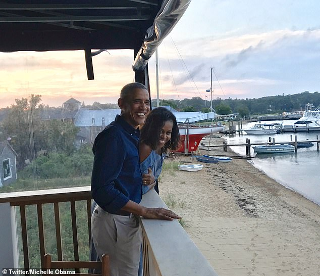 Romance: In her photo, the couple is pictured grinning on a porch near what appears to be a lake, with another sunset in the background