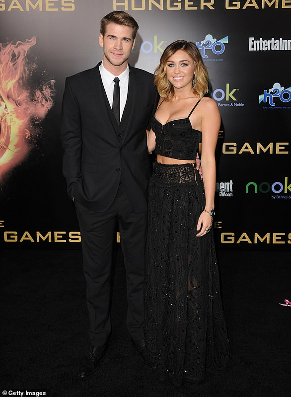 His big night: Shortly after Miley accompanied Liam to the premiere of his film The Hunger Games in March 2012, engagement rumors swirled