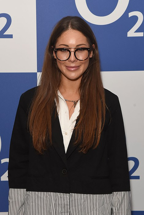 Stylish: Louise added a quirky pair of specs for some photographs